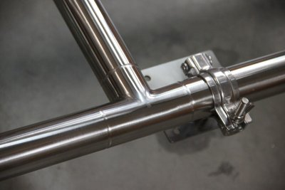 Close-up of tee welds and pump mount.