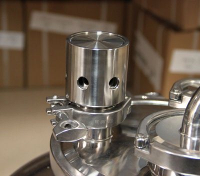 Pressure release valve on lid of conical